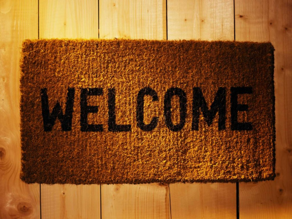 Doormat with 'welcome' written on it.